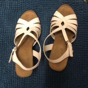 Lightly used pair of Aerosoles white sandal wedges